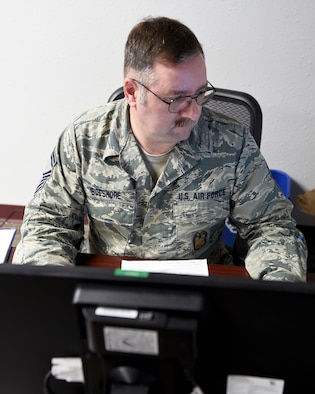 Senior Master Sgt. Carl Boeshore, 149th Fighter Wing Inspector General for Inspections superintendent, Texas Air National Guard, finishes some paperwork in his office, March 11, 2016, at Joint Base San Antonio-Lackland, Texas. Boeshore came to the unit in 2013 as the first enlisted person assigned to the IGI office when the program was still in its early stages. He plans to retire from the military, April 9, 2016, after 29 years of service.