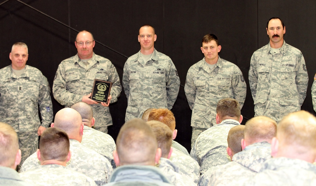 Tech. Sgt. Rodd Boyer,  Staff Sgt. John Baxter,  Tech Sgt. Ben Ott, and Tech. Sgt. Nathan Nichols takes a photo for winning overall grand champion at  the annual Missouri National Guard's 2016 State Adjutant General State Combat Match Rifle/Pistol Championships at Camp Crowder, Mo (Courtesy photo)