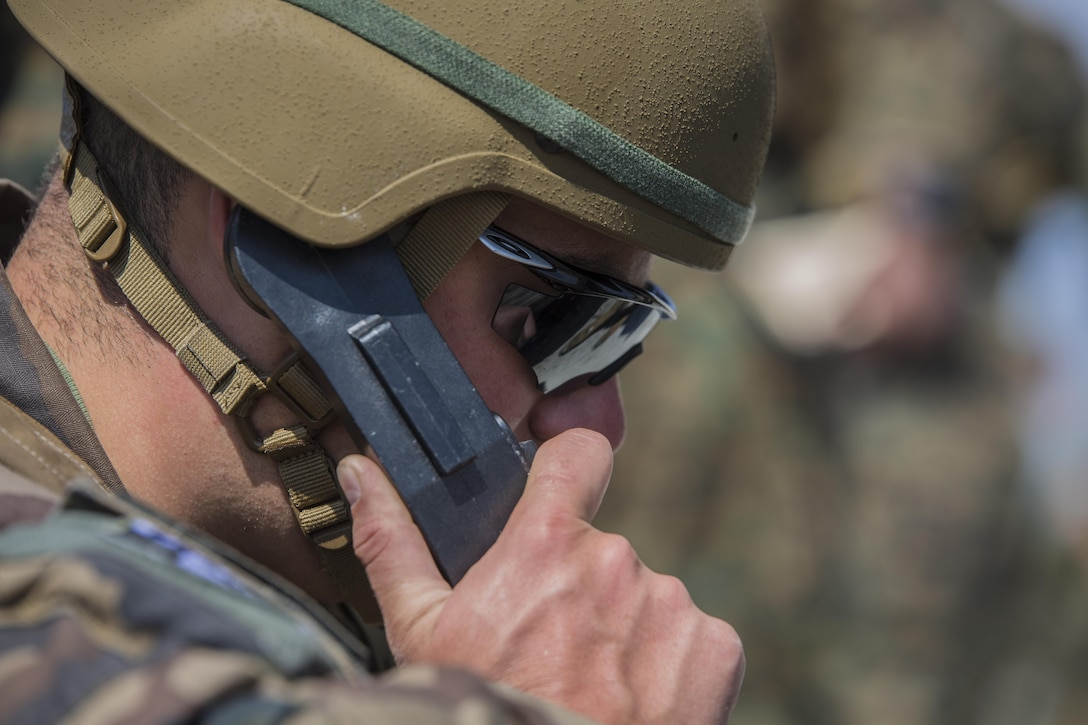 A Dutch Marine with 25 Reconnaissance Surveillance calls in targets and directs fires during a joint tactical air operation at Camp Lejeune, N.C., March 25, 2016. The training enhanced interoperability between the U.S., French, British, and Dutch forces, while the U.S. Marines provided fire and aviation support.  (U.S. Marine Corps photo by Lance Cpl. Erick Galera/Released)