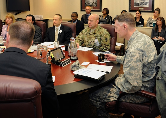 DLA Director Air Force Lt. Gen. Andy Busch (right) listens as staff members brief him on DLA Disposition Services' Annual Operation Plan.