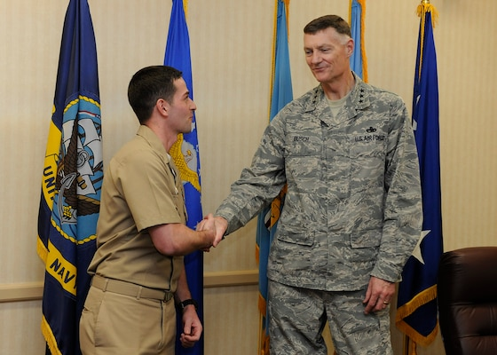 Busch presents a ceremonial coin to Navy Lt. Joseph Thomas for his work supporting expeditionary operations for DLA Disposition Services