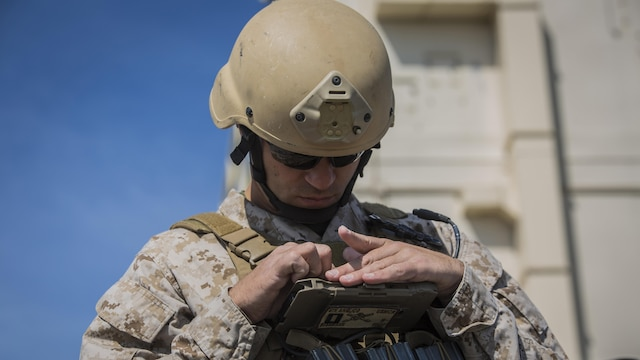 Capt. Richard Bussmann, a joint tactical air controller with 4th Air Naval Gunfire Liaison Company, takes notes as he directs fires during a joint tactical air operation at Marine Corps Base Camp Lejeune, North Carolina, March 25, 2016. 4th ANGLICO, a reserve unit, participated in the exercise to enhance interoperability between the U.S., French, British, and Dutch forces, while the U.S. Marines provided fire and aviation support.