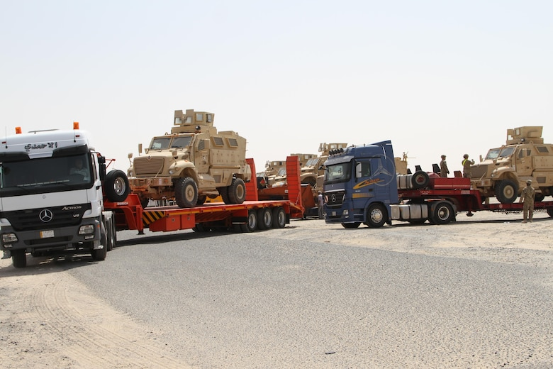 K-Crossing, Kuwait – Iraqi trucks line up as US Soldiers load Caiman MRAPs on their trailers. The delivery of 28 MRAPs to the Iraqi government is part of the US-led Iraqi Security Forces Development and Equipping Program. (US Army photo by Master Sgt. Dave Thompson, 1TSC Public Affairs)