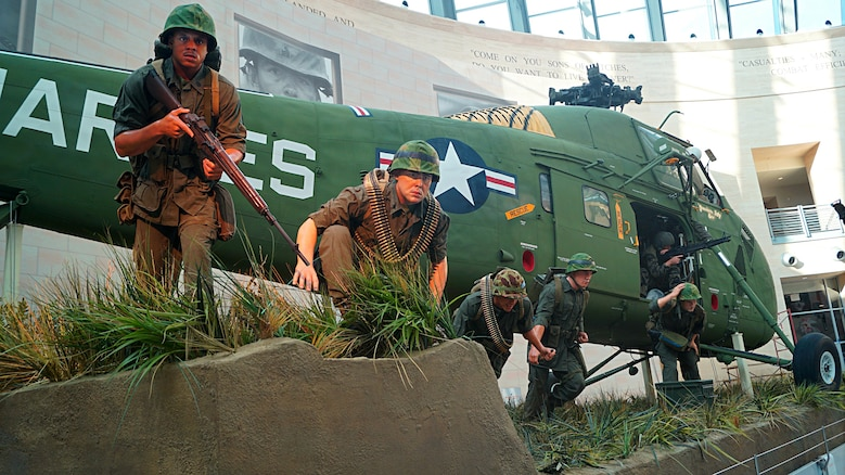 This new tableau depicts Marines heading for cover as they exit a Vietnam-era  Sikorsky UH-34D helicopter during Operation Starlite in 1965.  Active duty Marines and a Corpsman were used as models to create the cast  figures for the new tableau.