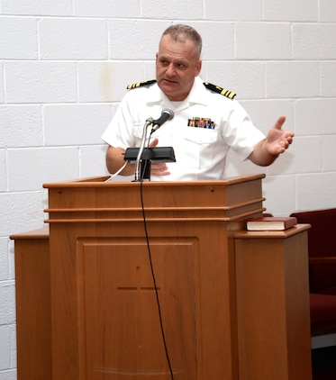 Lt. Cmdr. Erskine Alvis, chaplain, Headquarters and Support Battalion, Camp Lejeune, N.C., delivers the resurrection message to parishioners attending Easter Sunrise Service. The service was held inside the sanctuary of Marine Corps Logistics Base Albany's Chapel of the Good Shepherd, March 27.