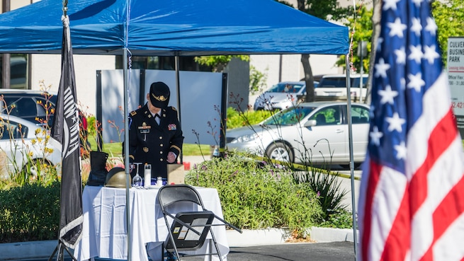 Maj. (Retired) Andrea Singer conducts the Missing Man Table and Honors Ceremony during the 50th Anniversary Commemoration of the Vietnam War at the West Los Angeles Vet Center, Culver City, Calif., March 29, 2016.