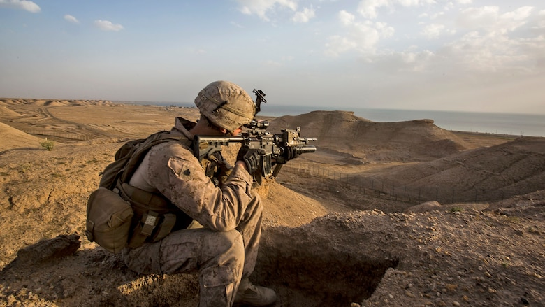 U.S. Marine Sgt. Josh Greathouse, a team leader with Company B, 1st Battalion, 7th Marine Regiment, Special Purpose Marine Air Ground Task Force - Crisis Response - Central Command, scans the area during a perimeter patrol in Al Taqaddum, Iraq, March 21, 2016. SPMAGTF-CR-CC Marines are responsible for the force protection of coalition assets at some Combined Joint Task Force – Operation Inherent Resolve bases within the U.S. Central Command area of responsibility as part of the effort to defeat the Islamic State of Iraq and Levant.
