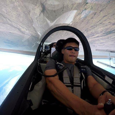 Cadet 2nd Class Khornwitpong Soonthonnitikul, an international student from Thailand at the U.S. Air Force Academy, flies upside down in a TG-16A glider during aerobatics training over Coolidge, Arizona. (Courtesy photo)