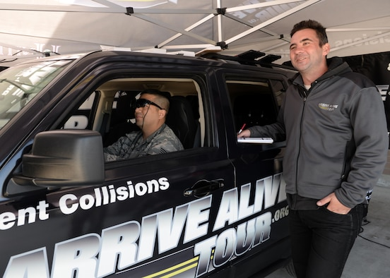 Staff Sgt. Ngoc-Lan (left), 548th Operation Support Squadron GEOINT program manager, operates a virtual simulated vehicle, which emulated being under the influence of alcohol during a demonstration from the Arrive Alive Tour March 29, 2016, at Beale Air Force Base, California. The Arrive Alive Tour provided a demonstration, which gave Airmen the opportunity to experience the realistic effects of driving under the influence, and texting while operating a vehicle.  (U.S. Air Force photo by Senior Airman Ramon A. Adelan)