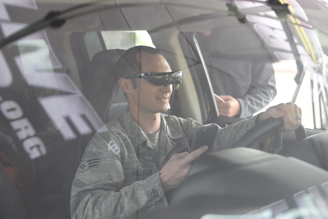 Senior Airman Ryan Milleman, 9th Aircraft Maintenance Squadron crew chief, operates a virtually simulated vehicle while he tries to text during a demonstration from the Arrive Alive Tour March 28, 2016, at Beale Air Force Base, California. The Arrive Alive Tour provided a demonstration, which gave Airmen the opportunity to experience the realistic effects of driving under the influence, and texting while operating a vehicle. (U.S. Air Force photo by Senior Airman Ramon A. Adelan)