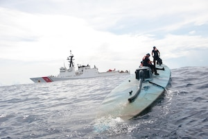 A Coast Guard Cutter Stratton boarding team investigates a self-propelled semi-submersible interdicted in international waters off the coast of Central America, July 19, 2015. The Stratton's crew recovered more than 6 tons of cocaine from the 40-foot vessel. Coast Guard photo by Petty Officer 2nd Class LaNola Stone