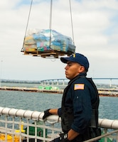 Coast Guard cutter Stratton crew members offload 34 metric tons of cocaine in San Diego, Aug. 10, 2015. The drugs were seized in 23 separate interdictions by Coast Guard cutters and Coast Guard law enforcement teams operating in known drug transiting zones. Coast Guard photo by Petty Officer Third Class Andrea Anderson