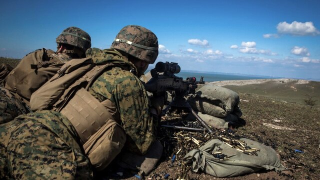U.S. Marines with Black Sea Rotational Force fire a M240 medium machine gun to provide supporting fires for Marines maneuvering through an assault course during Platinum Lynx 16-3 at Babadag Training Area, Romania, March 26, 2016. The purpose of Platinum Lynx is to build NATO allies' capabilities, reinforce relationships in a combined-training environment and increase operational proficiencies among U.S., Romanian, Slovenian, Bulgarian Forces.