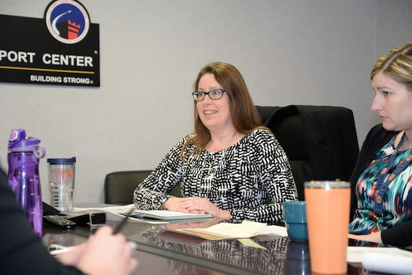 Carol Elder, Interior Design Section team lead for the U.S. Army Engineering and Support Center, Huntsville, meets with Interior Designer Lauren Ploetze and other members of the Huntsville Center Medical Interior Design team. Elder played a key role in standing up the interior design mission, an effort that began in 2010.