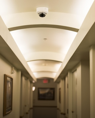 A security camera rests on the ceiling of one of the dorm building 2412 hallways at Mountain Home Air Force Base, Idaho, March 23, 2016. The cameras are planned to be installed only in common areas of the dorms such as stairwells, hallways and day-rooms in order to make the dorms safer for residents. (U.S. Air Force photo by Airman Alaysia Berry/RELEASED)