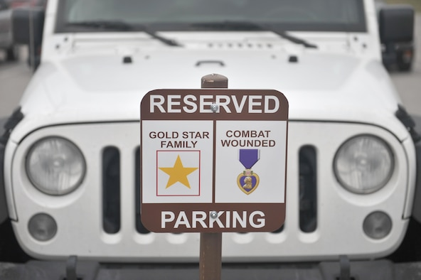 New signs have been posted on base to reserve parking spots for Combat Wounded Veterans and Gold Star Families. The reserved-parking signs were put up at the Commissary, Exchange, Offutt Field House and the Patriot Club. (U.S. Air Force photo by Zachary Hada)