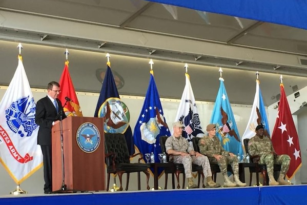 Defense Secretary Ash Carter delivers remarks during a change-of-command ceremony for U.S. Central Command at MacDill Air Force Base, Fla., March 30, 2016. Joining Carter on stage are, from left, Marine Corps Gen. Joe Dunford, chairman of the Joint Chiefs of Staff; Army Gen. Joseph Votel, incoming commander of Centcom; and outgoing commander Gen. Lloyd J. Austin III. DoD photo
