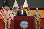 """Defense Secretary Ash Carter, Marine Corps Gen. Joe Dunford, chairman of the Joint Chiefs of Staff; Army Gen. Joseph Votel, commander of U.S. Central Command; and Army Gen. Raymond A. """"Tony"""" Thomas, commander of U.S. Special Operations Command, conduct a news conference in Tampa, Fla., March 30, 2016, following the change-of-command ceremonies for the two commands. DoD photo by Tiffany Miller"""