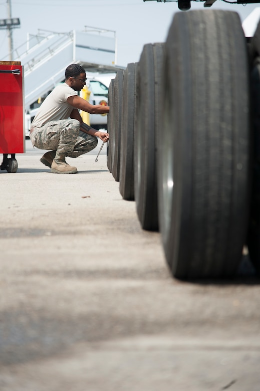 Staff Sgt. Sergio McLaughlin, 51st Logistics Readiness Squadron sorting generating and aircraft sustaining vehicle maintainer, checks tire pressure on a Tunner 60k loader at Osan Air Base, Republic of Korea, March 30, 2016. McLaughlin conducted a limited technical inspection that consisted of mechanical, electrical and hydraulic function checks. (U.S. Air Force photo by Staff Sgt. Jonathan Steffen/Released)