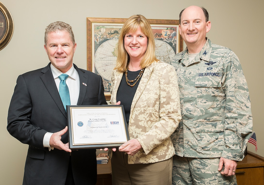 Craig Franklin, Craig Franklin CPA president, receives the Texas Employer Support of the Guard and Reserves' Patriot Award March 29, 2016. Franklin was nominated by Deborah Smith, a Craig Franklin CPA employee and the spouse of Col. Thomas K. Smith Jr., 433rd Airlift Wing commander.   (U.S. Air Force photo by Benjamin Faske) (released)