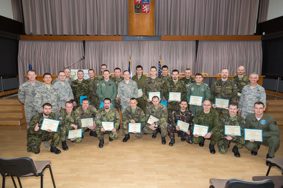 Students and Inter-European Air Forces Academy staff pose for a photo after graduation during a combined international officer and NCO mobile professional military education course in Brno, Czech Republic, March 4, 2016. Twenty-one students from Czech Republic, Hungary, Lithuania and Romania participated in the course. This was the IEAFA's second two-week course. IEAFA's first five-week in-residence course begins April 25, 2016 at Kapaun Air Station, Germany. (U.S. Air Force photo/Senior Master Sgt. Travis Robbins)