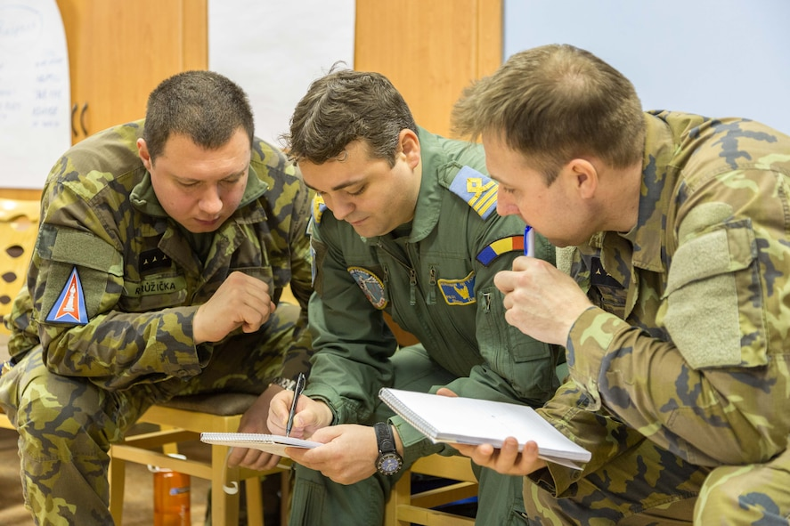 Inter-European Air Forces Academy officer and NCO students prepare and collaborate during a critical thinking exercise during a combined international officer and NCO mobile professional military education course in Brno, Czech Republic. Twenty-one students from Czech Republic, Hungary, Lithuania and Romania participated in the course. This was the IEAFA's second two-week course. IEAFA's first five-week in-residence course begins April 25, 2016 at Kapaun Air Station, Germany. (U.S. Air Force photo/Senior Master Sgt. Travis Robbins)
