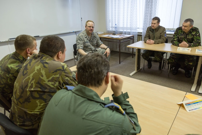 U.S. Air Force Maj. Joel Scherer, a Squadron Officer School instructor from Maxwell Air Force Base, Alabamba, debriefs officer and NCO students after an exercise during a combined international officer and NCO mobile professional military education course in Brno, Czech Republic. Twenty-one students from Czech Republic, Hungary, Lithuania and Romania participated in the course. This was the Inter-European Air Forces Academy's second two-week course. IEAFA's first five-week in-residence course begins April 25, 2016 at Kapaun Air Station, Germany. (U.S. Air Force photo/Senior Master Sgt. Travis Robbins)