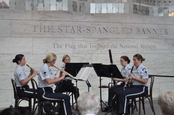 The U.S. Air Force Band Woodwind Quintet entertains visitors at the Smithsonian's National Museum of American History. March is Women's History Month, and The U.S. Air Force Band celebrates its heritage as it looks toward its future. (U.S. Air Force photo/released)