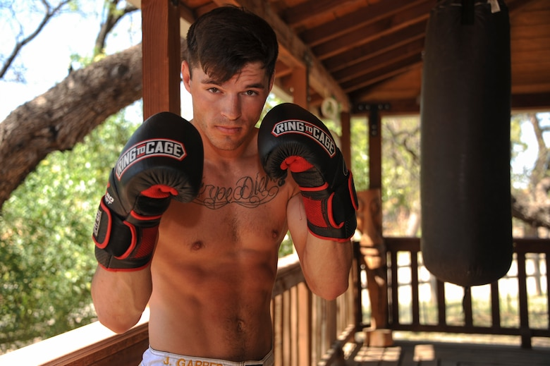 U.S. Air Force Senior Airman Jeremiah Garber, 355th Maintenance Group analyst, poses for a portrait during training at the Amity Circle Tree Ranch in Tucson, Ariz., March 26, 2016. Garber studies a variety of martial arts including Muay Thai and Brazilian Jiu jitsu. (U.S. Air Force photo illustration by Airman Nathan H. Barbour/Released)