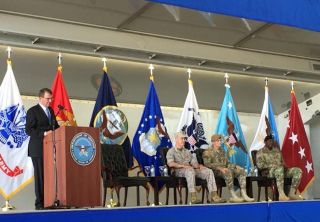 Defense Secretary Ash Carter delivers remarks during a change-of-command ceremony for U.S. Central Command at MacDill Air Force Base, Fla., March 30, 2016. Joining Carter on stage are, from left, Marine Corps Gen. Joe Dunford, chairman of the Joint Chiefs of Staff; Army Gen. Joseph Votel, incoming commander of CENTCOM; and outgoing commander Gen. Lloyd J. Austin III. (DoD photo)