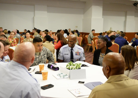 Chief Master Sgt. Michael McMillan, 36th Wing command chief, and his wife Tanya, center, participate in a conversation during the Joint Women's Leadership Symposium March 24, 2016, in Tumon, Guam. The symposium featured keynote speakers as well as two panels that focused on discussions regarding empowerment and how to become a more effective leader. (U.S. Air Force photo by Senior Airman Cierra Presentado)