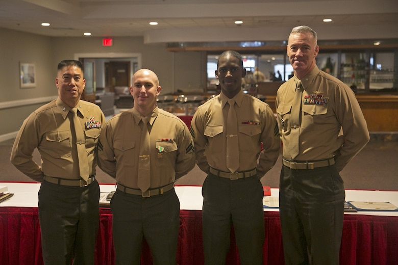 """MARINE CORPS BASE CAMP LEJEUNE, N.C. — The awardees pose during a breakfast to honor the MCIEAST Marine and sailor of the year at the Ball Center at Marine Corps Base Camp Lejeune Jan. 22. """"This is impressive to be selected out of all the Marines and sailors across multiple installations,"""" said Brig. Gen. Thomas Weidley, commanding general Marine Corps Installations East-Marine Corps Base Camp Lejeune. """"I think they exemplify the characteristics we expect of Marines and sailors."""""""