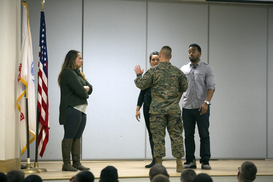 MARINE CORPS BASE CAMP LEJEUNE, N.C. — A Marine interacts with actors with Pure Praxis, a performance troupe, at Camp Johnson, Marine Corps Base Camp Lejeune Jan. 28. Marines were brought on stage to practice providing support and friendship to a victim of sexual assault.