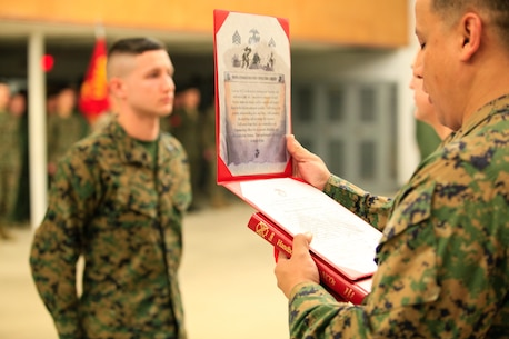 Manhattan, Kan.-native Gunnar A. Naughton, a team member with the Identification and Detection Platoon (IDP), Reaction Force Company, Chemical Biological Incident Response Force (CBIRF), U.S. Marine Forces Command (MARFORCOM),  is meritoriously promoted the rank of corporal during a battalion formation at Naval Support Facility Indian Head, Md., Mar. 2, 2016.