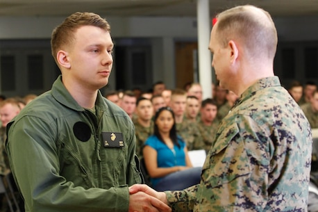 Chesapeake, Va.-native Lance Cpl. Ian N. Beck, infantryman and honor graduate, left, shakes hands with Col. Steve E. Redifer, commanding officer of the Chemical Biological Incident Response Force (CBIRF), U.S. Marine Corps Force Command (MARFORCOM), during a CBIRF Basic Operations Course graduation ceremony at Naval Support Facility Indian Head, Md., Mar. 11, 2016. The course is a three-week program that provides approximately 145 hours of classroom, practical applications and individual and team testing in chemical, biological, radiological, nuclear, and high-yield explosive (CBRNE) disciplines that meet federal requirements. After graduating the course, each Marine and sailor will be qualified to enter a contaminated area, search the area, provide emergency first aid and provide assistance to nonambulatory patients. Regardless of their jobs, or military occupational specialty, every Marine and sailor with CBIRF is required to complete the course, making the unit uniquely qualified to respond with minimal warning to a CBRNE threat. (Official USMC Photos by Sgt. Jonathan S. Herrera/Released)