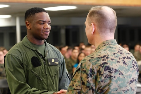 Riverdale, Ga.-native Pfc. Sandre E. Flournoy, logistics/embarkation specialist, left, shakes hands with Col. Steve E. Redifer, commanding officer of the Chemical Biological Incident Response Force (CBIRF), U.S. Marine Corps Force Command (MARFORCOM), during a CBIRF Basic Operations Course graduation ceremony at Naval Support Facility Indian Head, Md., Mar. 11, 2016. The course is a three-week program that provides approximately 145 hours of classroom, practical applications and individual and team testing in chemical, biological, radiological, nuclear, and high-yield explosive (CBRNE) disciplines that meet federal requirements. After graduating the course, each Marine and sailor will be qualified to enter a contaminated area, search the area, provide emergency first aid and provide assistance to nonambulatory patients. Regardless of their jobs, or military occupational specialty, every Marine and sailor with CBIRF is required to complete the course, making the unit uniquely qualified to respond with minimal warning to a CBRNE threat. (Official USMC Photos by Sgt. Jonathan S. Herrera/Released)