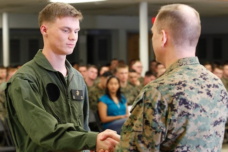 Akron, Ohio-native Pfc. Bradley J. Keen, aircraft rescue and firefighting specialist, left, shakes hands with Col. Steve E. Redifer, commanding officer of the Chemical Biological Incident Response Force (CBIRF), U.S. Marine Corps Force Command (MARFORCOM), during a CBIRF Basic Operations Course graduation ceremony at Naval Support Facility Indian Head, Md., Mar. 11, 2016. The course is a three-week program that provides approximately 145 hours of classroom, practical applications and individual and team testing in chemical, biological, radiological, nuclear, and high-yield explosive (CBRNE) disciplines that meet federal requirements. After graduating the course, each Marine and sailor will be qualified to enter a contaminated area, search the area, provide emergency first aid and provide assistance to nonambulatory patients. Regardless of their jobs, or military occupational specialty, every Marine and sailor with CBIRF is required to complete the course, making the unit uniquely qualified to respond with minimal warning to a CBRNE threat. (Official USMC Photos by Sgt. Jonathan S. Herrera/Released)