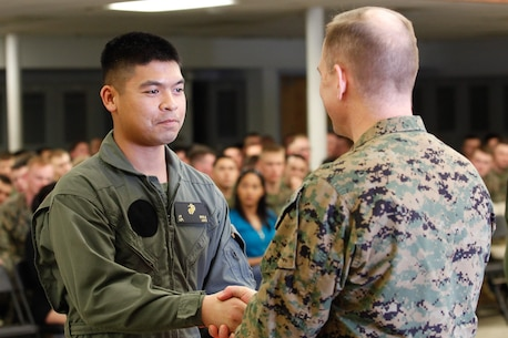 Norfolk, Va.-native Lance Cpl. Jason B. Embile, logistics/embarkation specialist, left, shakes hands with Col. Steve E. Redifer, commanding officer of the Chemical Biological Incident Response Force (CBIRF), U.S. Marine Corps Force Command (MARFORCOM), during a CBIRF Basic Operations Course graduation ceremony at Naval Support Facility Indian Head, Md., Mar. 11, 2016. The course is a three-week program that provides approximately 145 hours of classroom, practical applications and individual and team testing in chemical, biological, radiological, nuclear, and high-yield explosive (CBRNE) disciplines that meet federal requirements. After graduating the course, each Marine and sailor will be qualified to enter a contaminated area, search the area, provide emergency first aid and provide assistance to nonambulatory patients. Regardless of their jobs, or military occupational specialty, every Marine and sailor with CBIRF is required to complete the course, making the unit uniquely qualified to respond with minimal warning to a CBRNE threat. (Official USMC Photos by Sgt. Jonathan S. Herrera/Released)