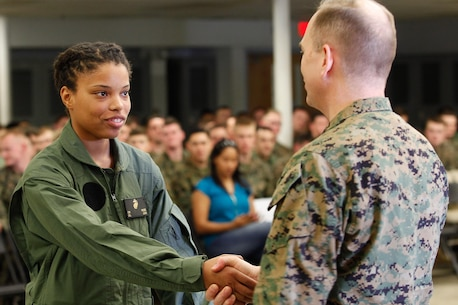 Orangeburg, S.C.-native Cpl. Cierra M. Woods, warehouse clerk, left, shakes hands with Col. Steve E. Redifer, commanding officer of the Chemical Biological Incident Response Force (CBIRF), U.S. Marine Corps Force Command (MARFORCOM), during a CBIRF Basic Operations Course graduation ceremony at Naval Support Facility Indian Head, Md., Mar. 11, 2016. The course is a three-week program that provides approximately 145 hours of classroom, practical applications and individual and team testing in chemical, biological, radiological, nuclear, and high-yield explosive (CBRNE) disciplines that meet federal requirements. After graduating the course, each Marine and sailor will be qualified to enter a contaminated area, search the area, provide emergency first aid and provide assistance to nonambulatory patients. Regardless of their jobs, or military occupational specialty, every Marine and sailor with CBIRF is required to complete the course, making the unit uniquely qualified to respond with minimal warning to a CBRNE threat. (Official USMC Photos by Sgt. Jonathan S. Herrera/Released)