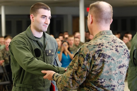 Marietta, Ga.-native Sgt. Benjamin D. Frazier, chemical, biological, radiological, and nuclear (CBRN) defense specialist, left, shakes hands with Col. Steve E. Redifer, commanding officer of the Chemical Biological Incident Response Force (CBIRF), U.S. Marine Corps Force Command (MARFORCOM), during a CBIRF Basic Operations Course graduation ceremony at Naval Support Facility Indian Head, Md., Mar. 11, 2016. The course is a three-week program that provides approximately 145 hours of classroom, practical applications and individual and team testing in chemical, biological, radiological, nuclear, and high-yield explosive (CBRNE) disciplines that meet federal requirements. After graduating the course, each Marine and sailor will be qualified to enter a contaminated area, search the area, provide emergency first aid and provide assistance to nonambulatory patients. Regardless of their jobs, or military occupational specialty, every Marine and sailor with CBIRF is required to complete the course, making the unit uniquely qualified to respond with minimal warning to a CBRNE threat. (Official USMC Photos by Sgt. Jonathan S. Herrera/Released)