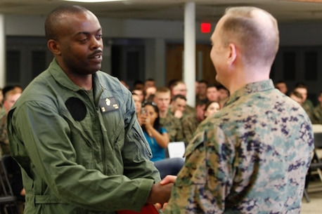 Baltimore-native Sgt. Magnus D. Nnolim, automotive maintenance technician, left, shakes hands with Col. Steve E. Redifer, commanding officer of the Chemical Biological Incident Response Force (CBIRF), U.S. Marine Corps Force Command (MARFORCOM), during a CBIRF Basic Operations Course graduation ceremony at Naval Support Facility Indian Head, Md., Mar. 11, 2016. The course is a three-week program that provides approximately 145 hours of classroom, practical applications and individual and team testing in chemical, biological, radiological, nuclear, and high-yield explosive (CBRNE) disciplines that meet federal requirements. After graduating the course, each Marine and sailor will be qualified to enter a contaminated area, search the area, provide emergency first aid and provide assistance to nonambulatory patients. Regardless of their jobs, or military occupational specialty, every Marine and sailor with CBIRF is required to complete the course, making the unit uniquely qualified to respond with minimal warning to a CBRNE threat. (Official USMC Photos by Sgt. Jonathan S. Herrera/Released)