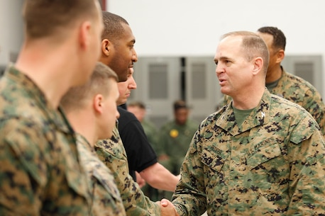 Col. Steve E. Redifer, right, commanding officer of the Chemical Biological Incident Response Force (CBIRF), U.S. Marine Corps Force Command (MARFORCOM), thanks the Marine and Civilian instructors of the Downey Responder Training Facility following a  CBIRF Basic Operations Coursegraduation ceremony at Naval Support Facility Indian Head, Md., Mar. 11, 2016. The course is a three-week program that provides approximately 145 hours of classroom, practical applications and individual and team testing in chemical, biological, radiological, nuclear, and high-yield explosive (CBRNE) disciplines that meet federal requirements. After graduating the course, each Marine and sailor will be qualified to enter a contaminated area, search the area, provide emergency first aid and provide assistance to nonambulatory patients. Regardless of their jobs, or military occupational specialty, every Marine and sailor with CBIRF is required to complete the course, making the unit uniquely qualified to respond with minimal warning to a CBRNE threat. (Official USMC Photos by Sgt. Jonathan S. Herrera/Released)