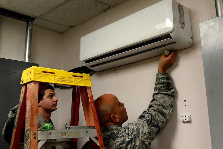 U.S. Air Force Staff Sgt. Carlos Ortiz-Castillo and Senior Airman Darek Vetter, 20th Civil Engineer Squadron heating, ventilation, and air conditioning technicians, reassemble and clean a heating and air conditioning evaporator at Shaw Air Force Base, S.C., March 28, 2016. The Airmen discovered a leak in the system and worked as a team to identify its location and repair the unit. (U.S. Air Force photo by Airman 1st Class Destinee Dougherty)