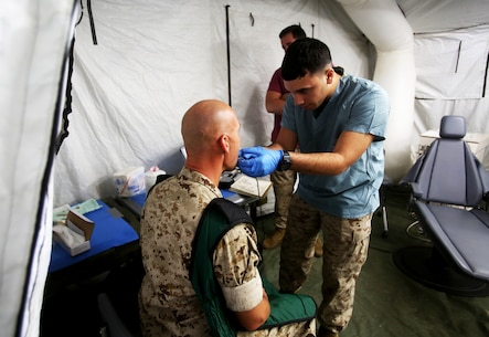 Seaman Nicholas Burns prepares a patient for a dental x-ray during Authorized Dental Allowance List Exercise aboard Camp Pendleton, Calif., March 13-25, 2016. Burns is a corpsman with 1st Dental Battalion, 1st Marine Logistics Group. ADALEX, which is being conducted for the first time in 10 years, is intended to increase the unit's expeditionary dental capabilities by operating in a field environment. (U.S. Marine Corps photo by Cpl. Carson Gramley/released)