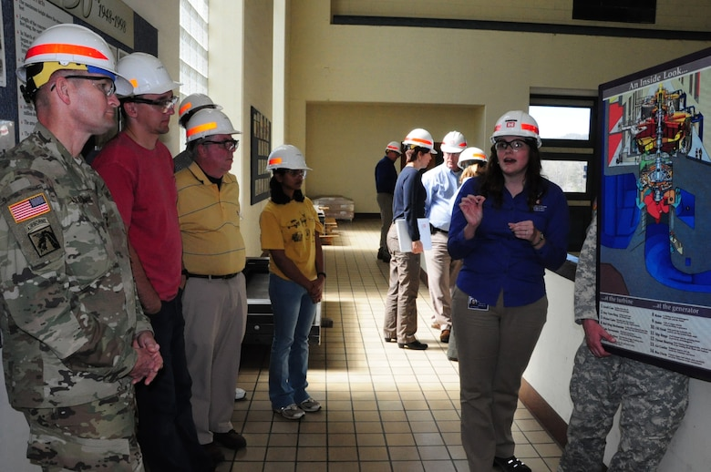 Maj. Gen. Donald Jackson, U.S. Army Corps of Engineers deputy commanding general for Civil and Emergency Operations, and the students look at the Center Hill Power House from the observation deck.  Loren McDonald, project manager and assistant program manager for the Nashville District Section 212 Program, explained to the group how a turbine and generator function.