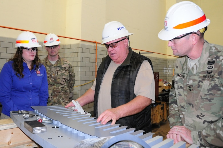 Martin Parker, site manager for Voith Hydro, explains the roles of a lamination sheet within a generator core with Maj. Gen. Donald Jackson during his visit to the Center Hill Hydropower Rehabilitation Project in Lancaster, Tenn., March 29, 2016.