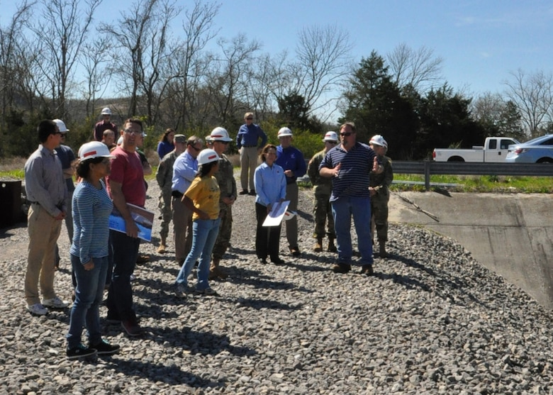 Bill DeBruyn, Center Hill project resident engineer, explains future work plans on the Saddle Dam to mechanical engineering students during a tour of the project March 29, 2016.