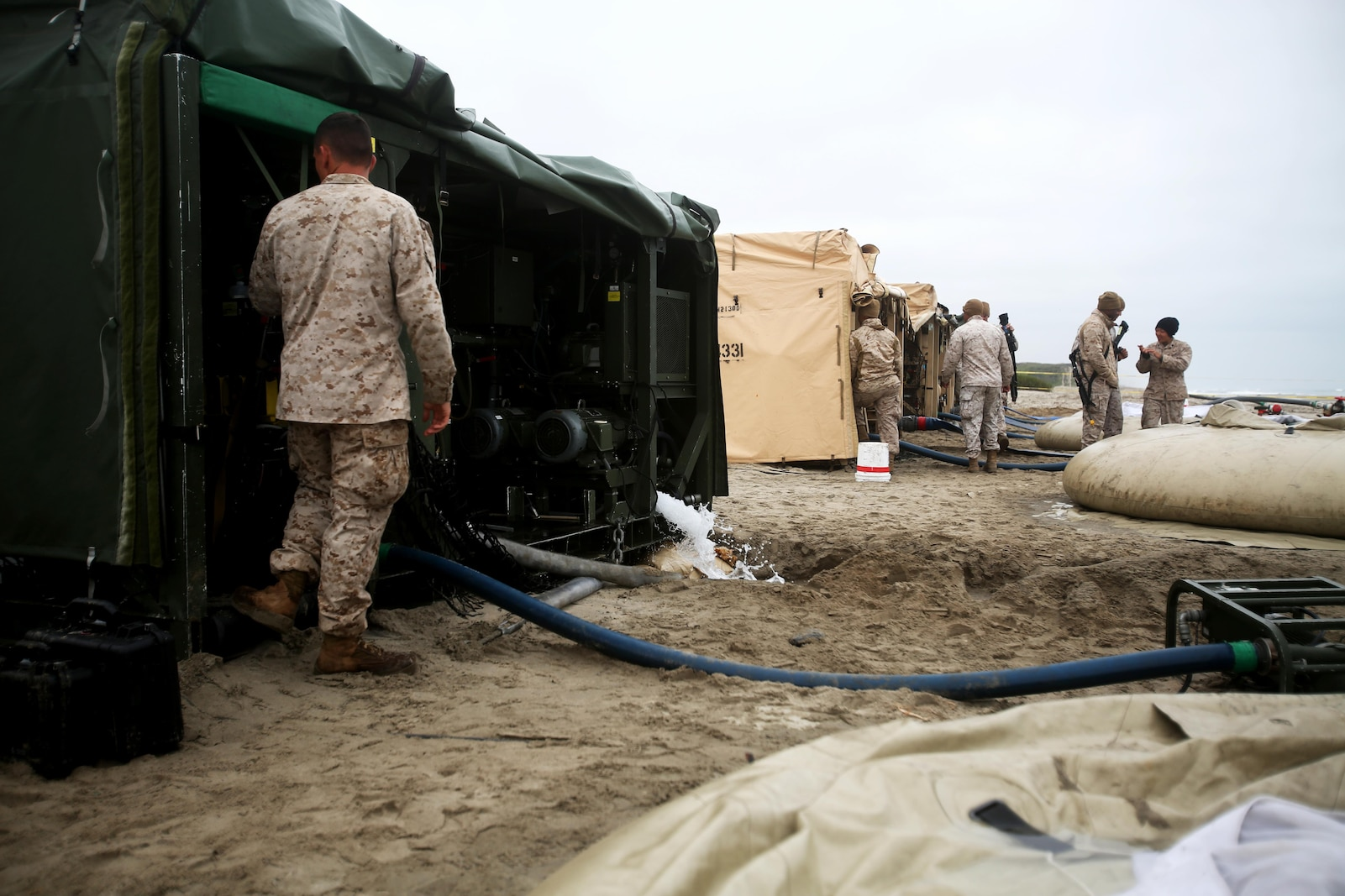Marines with Utilities Platoon, Headquarters and Support Company, 7th Engineer Support Battalion, 1st Marine Logistics Group, operate four tactical water purification systems during a utilities exercise at Red Beach aboard Camp Pendleton, Calif., March 21, 2016. Utilities Platoon conducted an eight-day field exercise which focused on their ability to provide clean water and stable power to a unit located in an environment without standard utility resources. (U.S. Marine Corps photo by Cpl. Carson Gramley/released)
