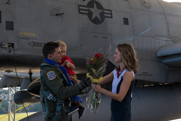 U.S. Air Force Capt. James Knauss, 74th Expeditionary Fighter Squadron A-10C Thunderbolt II pilot, greets his wife and son, James and Hannah, as he returns from a deployment, March 22, 2016, at Moody Air Force Base, Ga. Approximately 10 Moody A-10C Thunderbolt II's contributed to multiple events and exercises while visiting 15 countries, conducting nearly 1,190 sorties in support of Operation Atlantic Resolve. (U.S. Air Force photo by Airman 1st Class Greg Nash/Released)