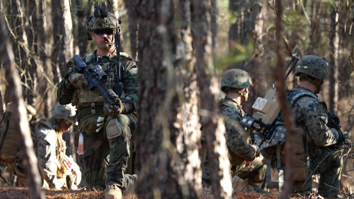 Marines Raiders from Company F, 2d Marine Raider Battalion, led a simulated partner nation force on ground combat patrolling tactics, techniques  and procedures during a Company Collective Exercise in Fort Bragg, South Carolina, Feb. 28, 2016. The Marine Special Operations Company and individual teams where tested on their execution of basic skills as well as learned and honed new tactic, techniques and procedures.